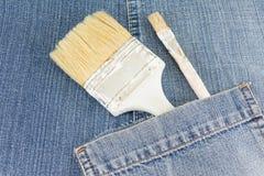 Malować muśnięcie w niebiescy dżinsy kieszeni obrazy royalty free