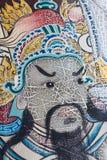 Malować twarz antyczny Azjatycki wojownik na drzwi w Wacie Pho jest t Obrazy Stock