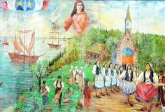 Malowidło ścienne mówi opowieść acadians ludzie Obrazy Stock