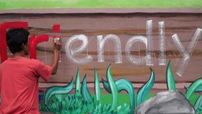 Malowidło ścienne malarz rysuje list ja na betonowej ścianie Czasu upływ zbiory