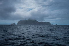Malpelo Island Colombia. Arriving Malpelo island with thick clouds and rain Royalty Free Stock Photos
