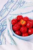 Malpighia glabra (red acerola), tropical fruit in bowl. Selective focus Stock Image