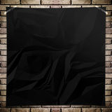 Malplaatje Zwarte verfrommelde vierkante Affiche op grungebakstenen muur Royalty-vrije Stock Foto
