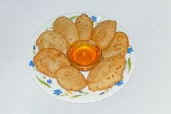 Malpua- Indian traditional dessert or pancake for festivals, served in plate with Jaggery Syrup. royalty free stock image