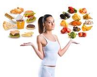 Malsano contra la comida sana Imagenes de archivo