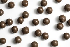 Malt Balls. With chocolate shot close up on a white background Royalty Free Stock Photo