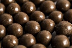 Malt Balls. With chocolate shot close up on a white background Royalty Free Stock Photos