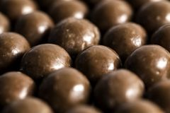 Malt Balls. With chocolate shot close up on a white background Royalty Free Stock Images