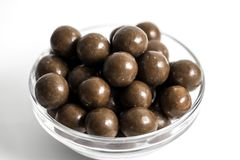 Malt Balls. With chocolate shot close up on a white background Stock Photo