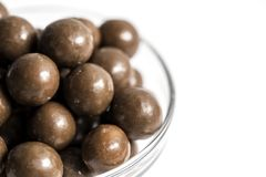 Malt Balls. With chocolate shot close up on a white background Stock Photos