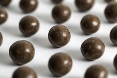 Malt Balls. With chocolate shot close up on a white background Stock Image