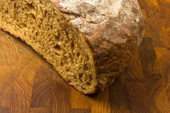 Malt bread handmade. Cut malt bread handmade on wooden background Royalty Free Stock Images