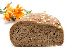 Malt grain bread slices. And with flowers Royalty Free Stock Photography