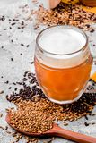 Malt grain and a glass of beer. Mixed varieties of malted grain on a gray background. close-up. Top view. flat lay. series of photos. space royalty free stock photography