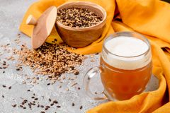 Malt grain and a glass of beer. Mixed varieties of malted grain on a gray background. close-up. Top view. flat lay. series of photos. space stock image