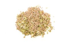 Malt and hop heap isolated. Top view. Mix of green dry hop leaves and malt grain isolated on white background royalty free stock images