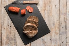 Malt loaf bread and chorizo slices. On table Stock Image