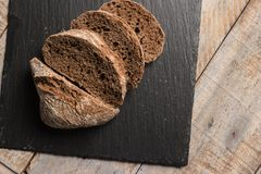 Malt loaf bread. Slices on table Royalty Free Stock Image