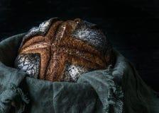 Malt rye bread with poppy seeds dark photo. Homemade malt rye bread with poppy seeds dark photo royalty free stock image