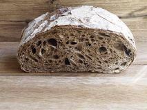Malt rye bread. On wood background Royalty Free Stock Images