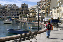 Malta. The teenager goes for a walk till quay of Malta Stock Image