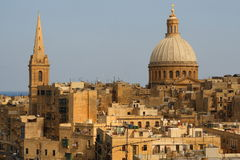 Malta. Yellow hauses of Valletta, Malta and St. Paul's Angclican Cathedral and Carmelite Church Stock Image
