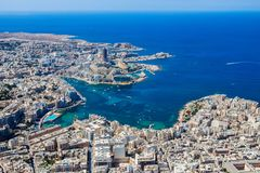 Malta aerial view. St. Julian`s San Giljan and Sliema cities. Towns and coastline of Malta from above. Skyscraper in Paceville. Malta aerial view. St. Julian`s royalty free stock photo