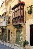 Malta august 2015 Valletta street ornamental plants on a stone house royalty free stock photos