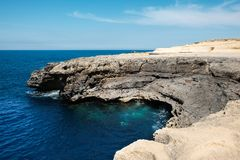 Malta is the best destination. Malta 2018 - rocky shore and the blue mediterranean sea at Gozo island Stock Photography