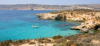 Malta Blue Lagoon. On Comino island between Malta and Gozo, popular touristic destination Stock Photos