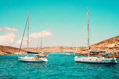 Malta Blue Lagoon and mountainous coast beauty water and boat Stock Images