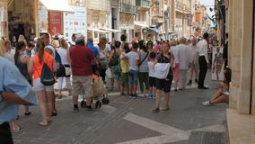 MALTA CAPITAL VALLETTA CITY CENTRE, PEDESTRIAN STREET - JULY 2016: Many tourist and local people shopping in the old stock video