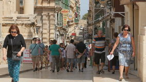 MALTA CAPITAL VALLETTA CITY CENTRE, PEDESTRIAN STREET - JULY 2016: Many tourist and local people shopping in the old stock video footage