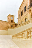 Malta Citadel architecture Gozo island. View of the medieval citadel courtyard with clock tower, Victoria, Gozo Island, Malta Royalty Free Stock Photos