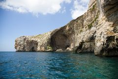 Malta cliffs at Blue Grotto from sea level Stock Photos