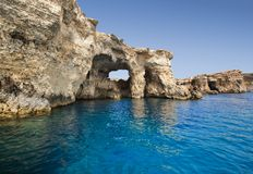 Malta cliffs at sea level. And blue sky stock photography