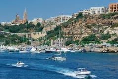 Malta Coastline. Coastline with marina and town on the island of Gozo in Malta Stock Photos