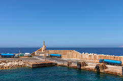 Malta, Coastline view. Ferry terminal infrastructure in the northwestern part of the mainland, Cirkewwa, Malta Stock Photo