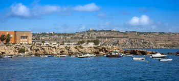 Malta, Coastline view. Panoramic view of the old fishing village of St Pauls Bay, San Pawl il-Baħar, popular tourist destination in the northwestern part of Royalty Free Stock Photo