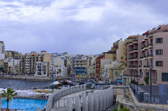 Malta, Coastline view. Modern buildings on the waterfront in the old fishing village of St Pauls Bay, San Pawl il-Baħar, Malta Royalty Free Stock Image