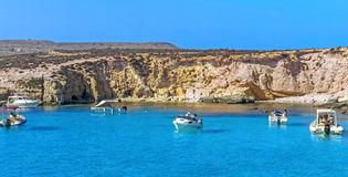 Malta - Comino, Blue Lagoon. The Blue Lagoon, a sheltered inlet of shimmering aquamarine water, the main attraction on the tiny island of Comino, Malta Stock Photos