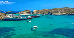 Malta - Comino, Blue Lagoon. The Blue Lagoon, a sheltered inlet of shimmering aquamarine water, the main attraction on the tiny island of Comino, Malta Royalty Free Stock Photos