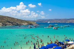 Malta - Comino, Blue Lagoon. The Blue Lagoon, a sheltered inlet of shimmering aquamarine water, the main attraction on the tiny island of Comino, Malta Stock Image