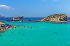 Malta - Comino, Blue Lagoon. The Blue Lagoon, a sheltered inlet of shimmering aquamarine water, the main attraction on the tiny island of Comino, Malta Royalty Free Stock Photography