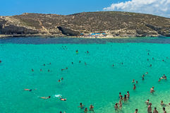 Malta - Comino, Blue Lagoon. The Blue Lagoon, a sheltered inlet of shimmering aquamarine water, the main attraction on the tiny island of Comino, Malta Stock Images