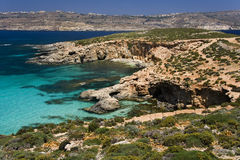 Malta - Comino & Gozo. The Blue Lagoon on the small island of Comino with the island of Gozo in the distance. Malta Stock Image