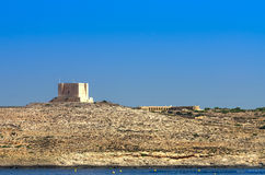 Fortifications of Malta - Comino. The tower of St Mary, the most imposing building on the smallest island in the Maltese Archipelago. This watchtower was erected Royalty Free Stock Images