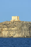 Fortifications of Malta - Comino. The tower of St Mary, the most imposing building on the smallest island in the Maltese Archipelago. This watchtower was erected Stock Image