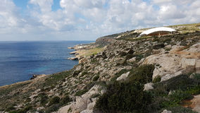 Malta costal landscape. With Hagar Qim temple in the background Royalty Free Stock Image