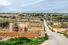 Malta countryside with red old castle in the background. Malta countryside with red old castle in the back Royalty Free Stock Image